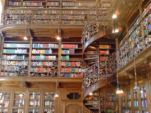 Floor to ceiling bookcase. Spiral staircase. Double win.