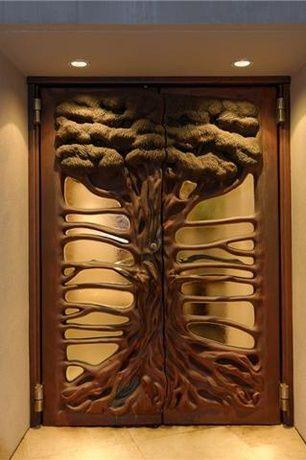 Eclectic Front Door with exterior tile floors, Raised beds, Pathway, Summit Hand Carved Front Door, Glass panel door