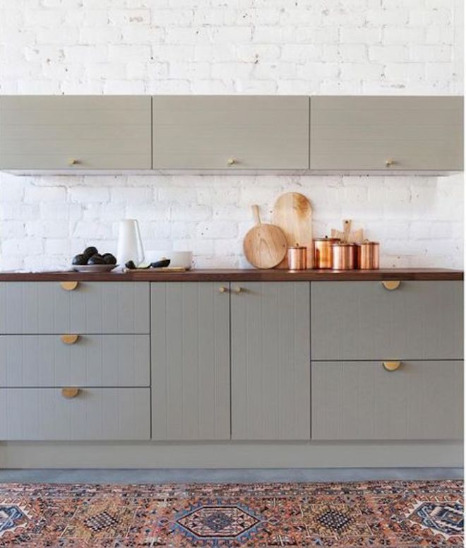 Clean flat front cabinetry, when paired with otherwise traditional finishes and styling in a kitchen, feel like a fresh update. Take a look.