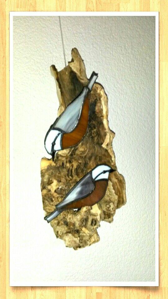 Stained glass birds on wood by Tinus Verheijen