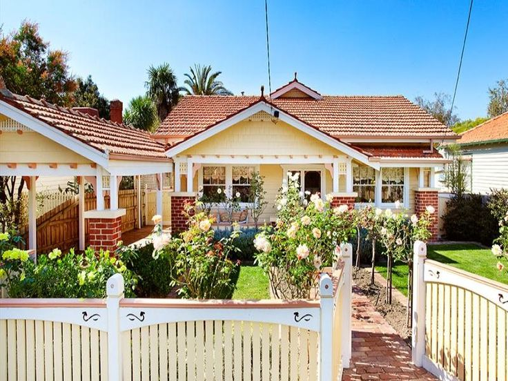 Brick californian bungalow house exterior with picket fence  landscaped garden - House Facade photo 258291