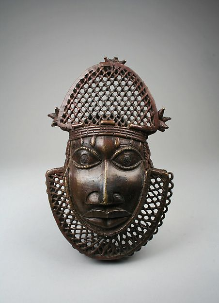 Hip Ornament: Face  Date:16th–19th century  Geography:Nigeria, Court of Benin  Culture:Edo peoples  Medium:Brass, iron  Dimensions:Height 7-1/2 in.