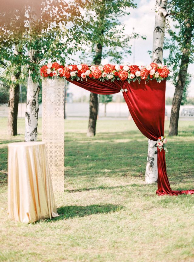 Cranberry Red and Gold Wedding decorations floral arches and backdrops