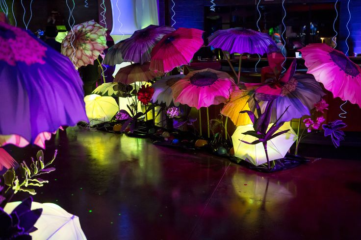 our jumbo flowers for the reception...They were umbrellas with a flower printed on them, take a light and make them glow!