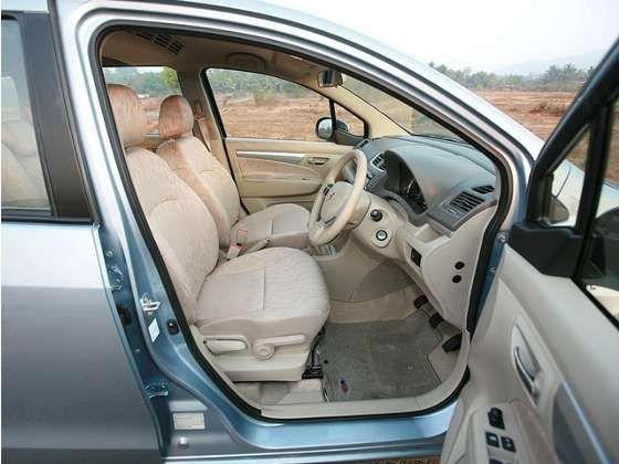 A great recipe for cleaning car upholstery: Combine 6 tablespoons soap flakes (from a bar of Fels Naptha or Linda's soap found in the laundry aisle) with 2 tablespoons Borax--add 1 pint boiling water until ingredients dissolve. Let cool, then whip until a 'foam' is created. You can then brush it directly onto the fabric and wipe away with a damp sponge or cloth.