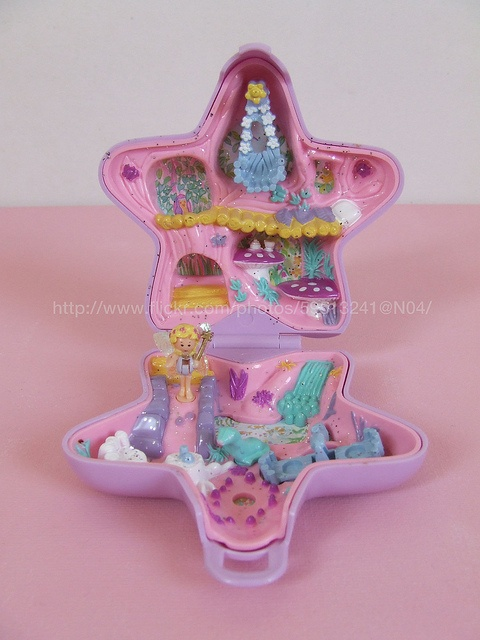 Polly Pockets! We had this set, too. :)