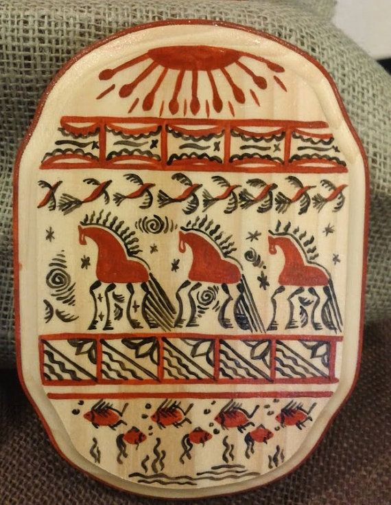 Horses painting on wooden board in the Russian traditional Mezen style, folk art painting on wood