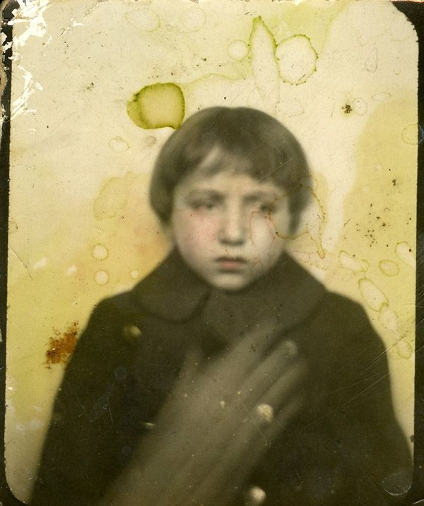 This is creepy. Child looks deeply troubled, and what's with the creepy smeared hand that looks all ghosty? (The Boat Lullabies...odd photobooth)