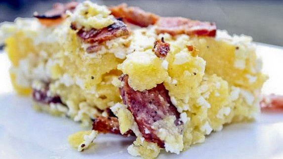 Traditional Romanian Polenta with Feta Cheese and Bacon (Mamaliga cu Branza in Paturi)