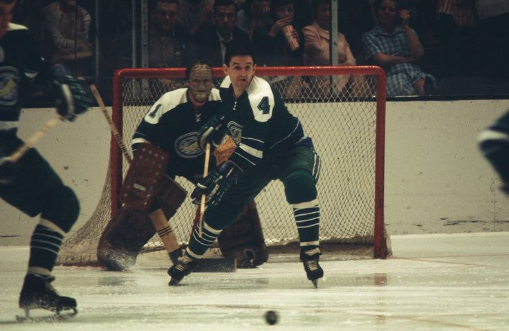"Wayne Muloin defends the Oakland net in front of goalie, Charlie Hodge, 1969-70. - http://www.hhof.com/LegendsOfHockey/jsp/SearchPlayer.jsp?player=13795  -snip- ""...Oakland Seals invited me to camp and I decided to play it really aggressive,"" Wayne recalled. "" I racked up guys like Carol Vadnais and Mike Laughton with some good hits and they had to keep me around...."" - http://www.greatesthockeylegends.com/2009/11/wayne-muloin.html"