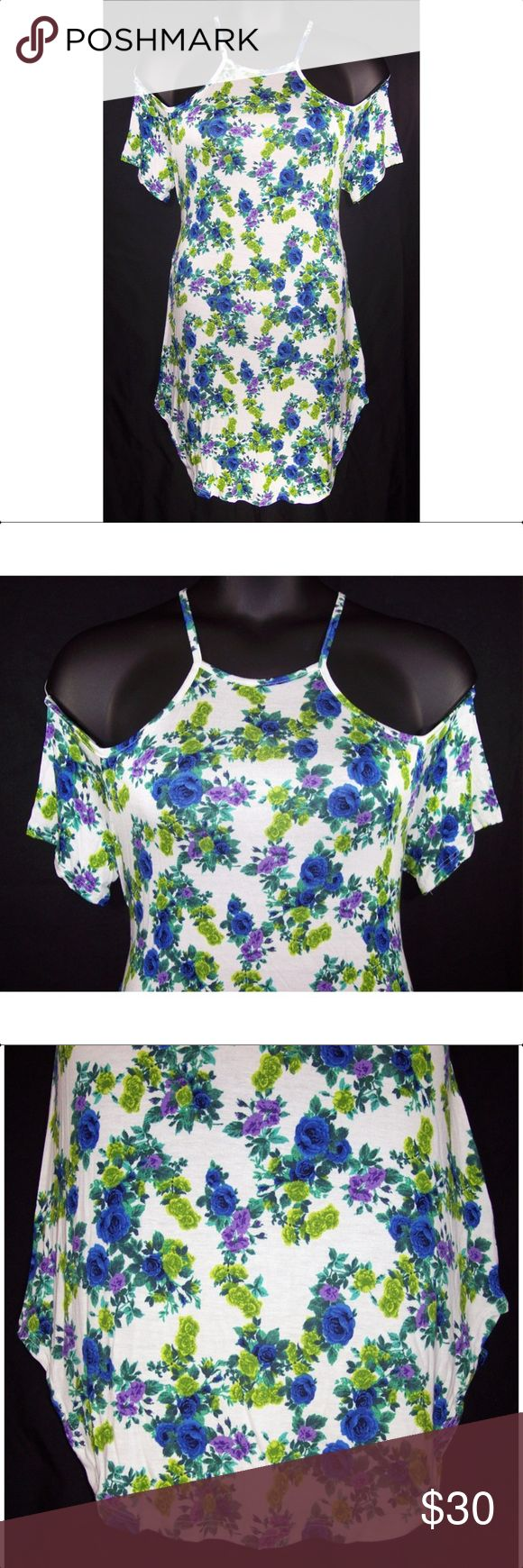 YUMMY PLUS 1X 2X 3X White Floral Tank Top-NEW Its white with a blue, purple, and green Floral design throughout. Is cold shoulder style with spaghetti straps, curved hem, soft lightweight knit fabric is 95% rayon, 5% spandex, hand washable. Measurements: 1X bust-38 to 48 (stretched), length- 33 1/2. 2X bust-42 to 52 (stretched), length-34. 3X bust-44 to 54 (stretched), length-34 NWOT Yummy Plus Tops Tank Tops