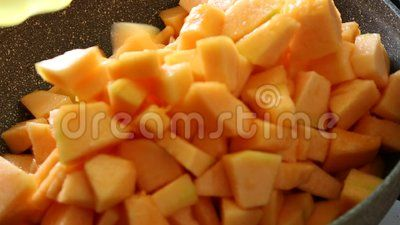 Fresh pieces of melon in bowl.