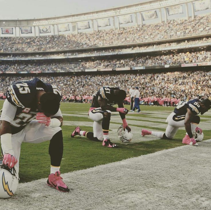 Chargers Players Take A Knee