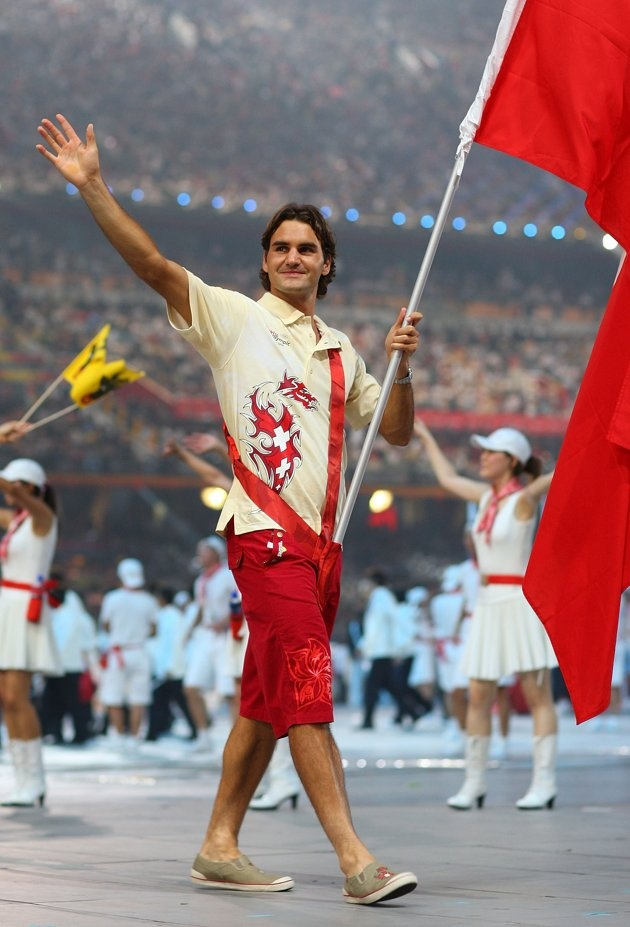 Seventeen-time Grand Slam winner and 7-time Wimbledon champion Roger Federer carries the Swiss flag at the Beijing Olympics.  Switzerland has asked him to carry the flag again, but he's considering passing it on to a lesser-known athlete.