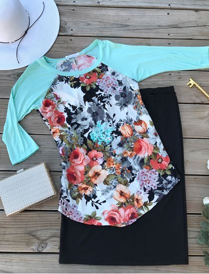 Bold multi-color floral bodice with mint 3/4 sleeves.