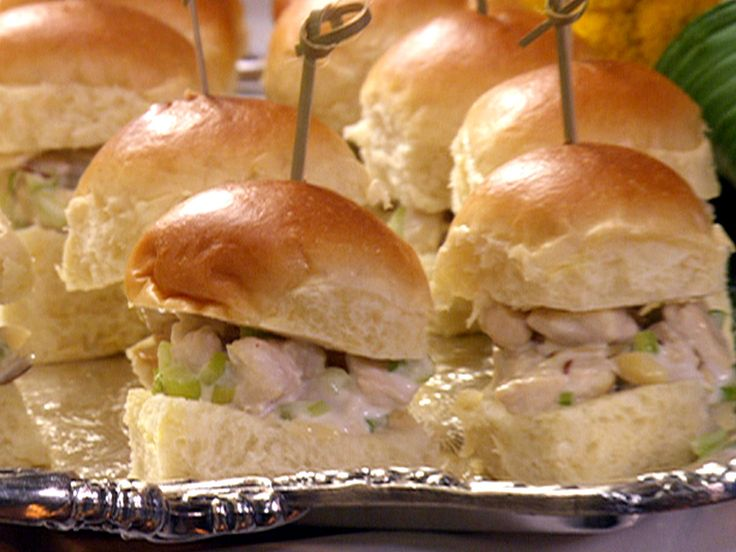 Chicken Salad Sliders from FoodNetwork.com...Make this all time but I add walnuts instead of almonds and I also add dried cranberries and golden raisins and I double the dressing.