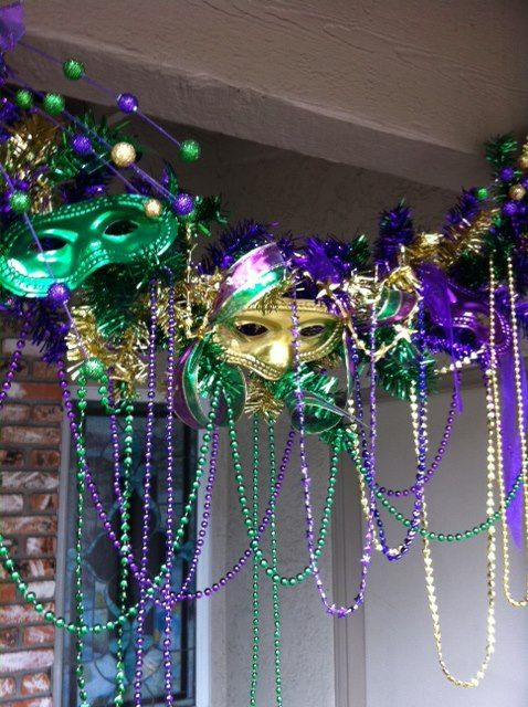 Mardi Gras Decor - This would be so much cooler rather than just plain little strands of beads hanging from the outside of the pop-up!