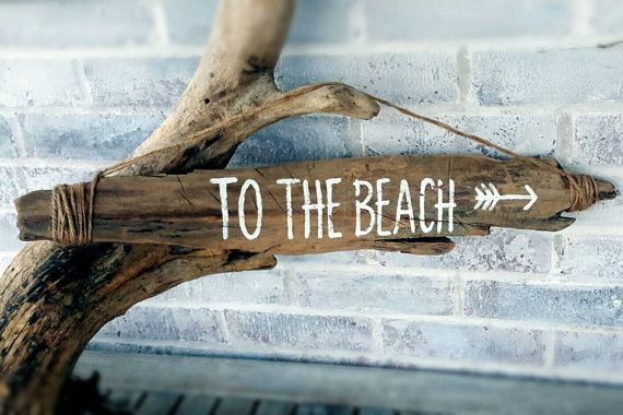Painted driftwood sign