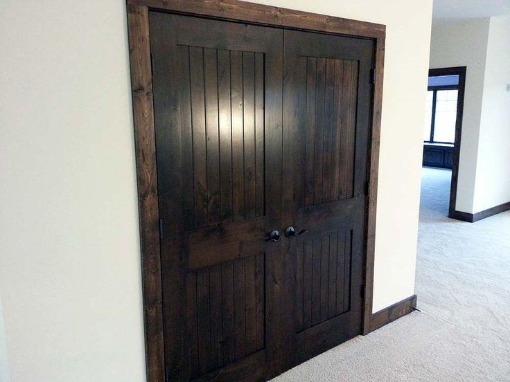 Prefer this super dark stained doors with dark wood trim for Wood trim around doors