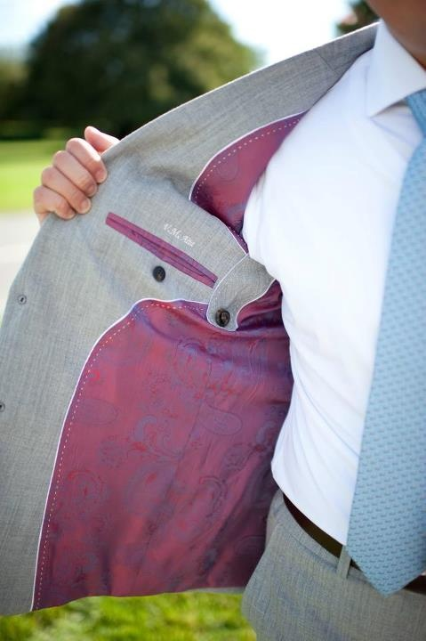 Alabaster & Chess pink and purple patterned lining with light grey wedding suit