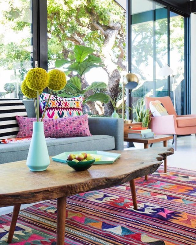 This bright happy space by @Emily Henderson Design is full of personality  love the kilim rug and use of global textiles
