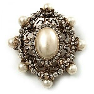 Antique gold ivory pearl brooch.