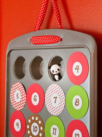 With its 24 openings, a mini-muffin pan makes a perfect base for a treat-filled Advent calendar. Because the numbered coverings are held on by magnets, you'll be able to bake with the pan again after Christmas.                 1. Cut 24 circles 2 1/4 inches wide from a 12- by 24-inch adhesive magnetic sheet. Adhere them to patterned paper, then cut them out.                 2. With a 1-inch circular punch, make 24 paper circles. Number them and use a glue stick to attach them to the…