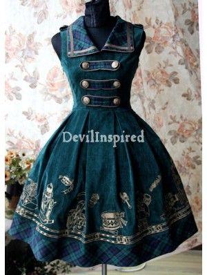 pretty green/gold velvet dress. I like the tartan plaid on the collar, closures on bodice, and bottom hem -- nice touch.