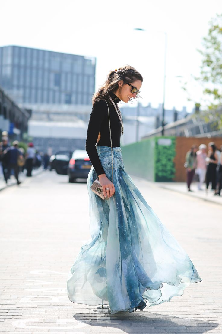 @rosannafalconer wears the patina galaxy maxi skirt at London Fashion Week. She pairs it with a black body and statement necklace #ohMW #LFW #SS16