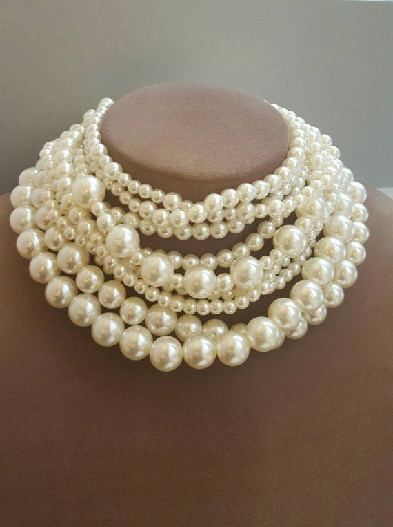 Check out this item in my Etsy shop https://www.etsy.com/ca/listing/499653214/thick-choker-necklace-multistrand-pearl