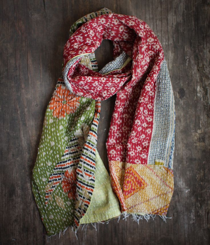 Say hello to India with this soft cotton scarf repurposed from vintage saris. This reversible kantha scarf features a running hand stitch that creates a unique texture and feel to this one-of-a-kind scarf. Textiles don't get better then this!
