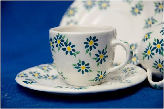 Hand made and hand painted Miniature teacup and saucer with blue & yellow flowers on white ceramic background