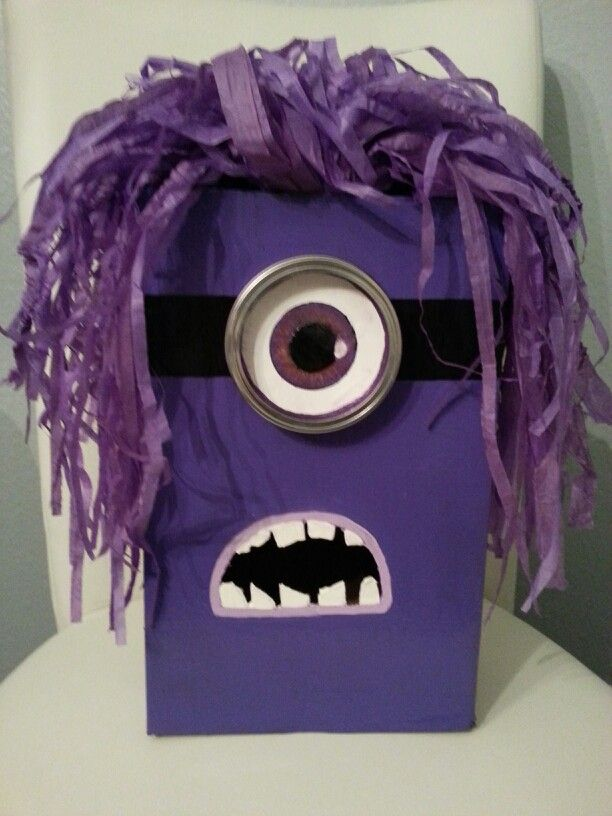 Purple Minion Valentine Box. I may or may not have taken over Macy's Valentine Box project when she lost interest and went to bed.  Shoe box Black, purple, white and bronze craft paint, Mason jar ring, Exacto knife Purple tissue paper run through shredder Epoxy or heavy duty glue to bond monacle to shoe box.