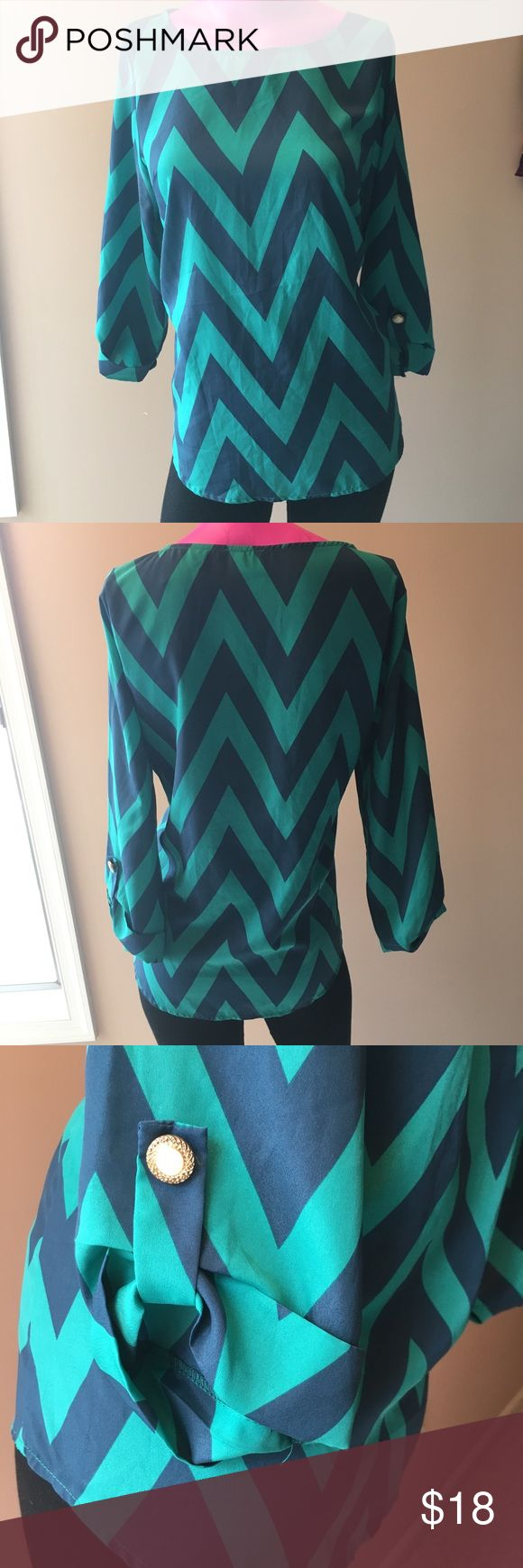 DINA BE Chevron Top NWOT teal and navy long sleeve top. Silky material without much stretch. Gold buttons to roll up sleeves if desired. Boatneck. Let me know if you need measurements! dina be Tops