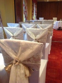 Lace chair covers with champagne sash and finished with my handmade flower