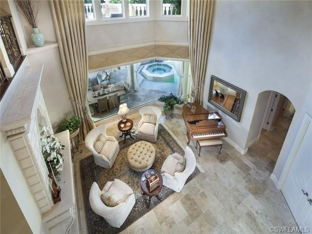 Formal living room with piano and fireplace. Port Royal in Naples ...