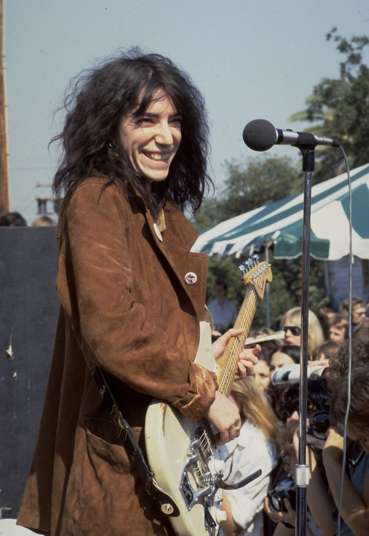 Long before the days of hair oils and frizz fighters, Patti Smith made fuzzy hair the height of cool. See more rockers who fuel our hair envy!