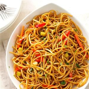 Thai Pasta with Spicy Peanut Sauce Recipe -We love how the whole wheat pasta and crisp, raw vegetables blend with the rich and creamy peanut sauce. The addition of fresh lime juice really brightens the flavor of the dish. Some eat it hot, but my husband and I prefer to wait until it's closer to room temperature. —Donna McCallie, Lake Park, Florida