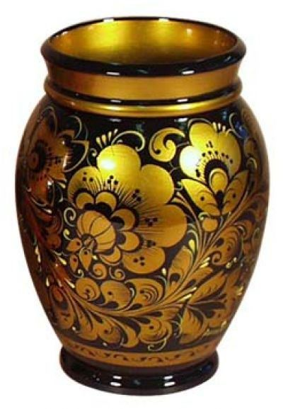 A wooden vase is decorated with Russian folk Khokhloma painting.