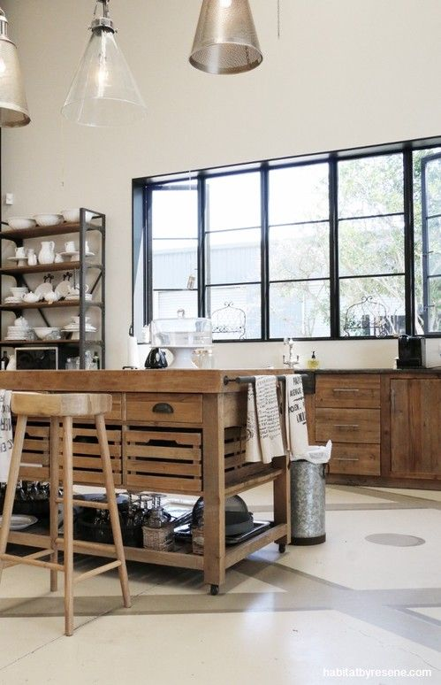 For a slightly warmer take on the Scandi style, CC Interiors designed this kitchen in their showroom using Resene Quarter Akaroa on the walls. The windows are painted in Resene Black.