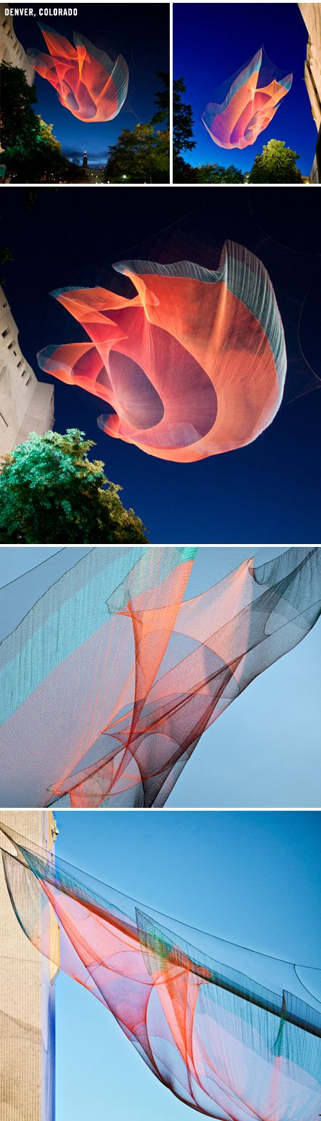 American artist Janet Echelman makes huge, sculptural nets that are colorful and billowing during the day, and light up the skyline like beautifully bizarre jellyfish at night.