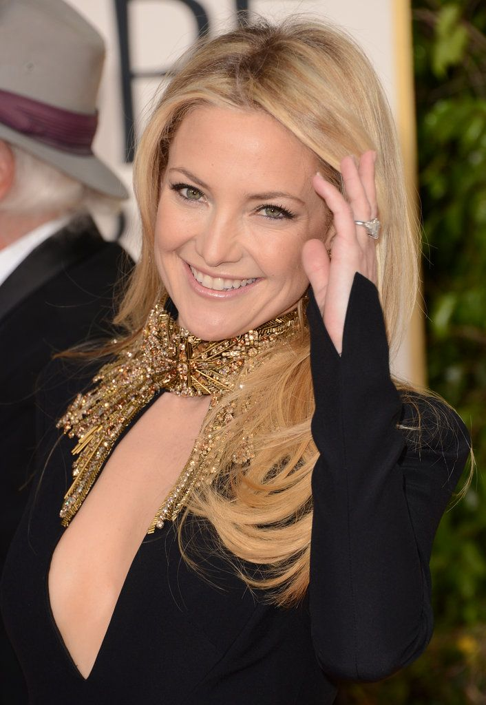 America sweetheart Kate Hudson flashed her engagement ring on the red carpet at the Golden Globes on Jan.13,2013