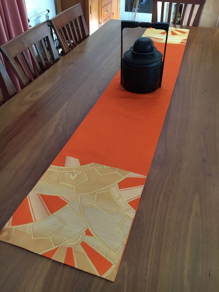 A personal favourite from my Etsy shop https://www.etsy.com/au/listing/386694242/vintage-japanese-obi-table-runner-orange