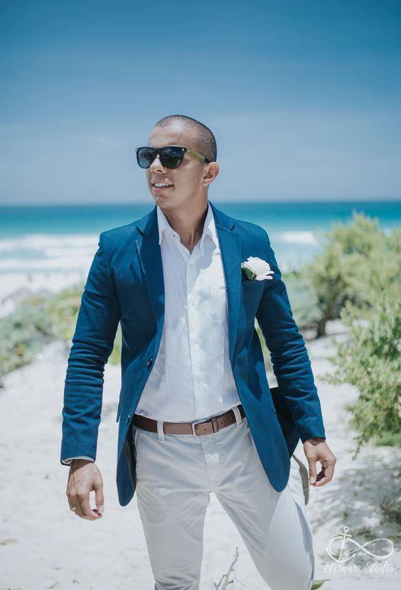 65481cd733d8 chic beach groom outfit with a navy jacket
