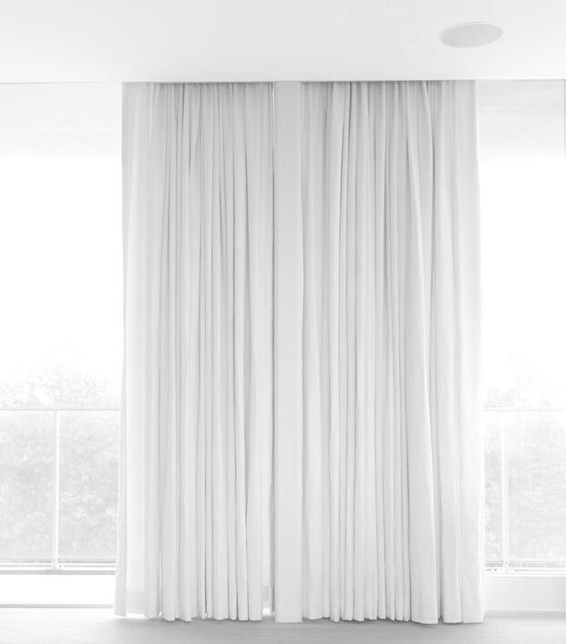 Floor To Ceiling Soft Drapes And Oatmeal Woven Carpet For Minimal,  Understated Bedroom Luxury
