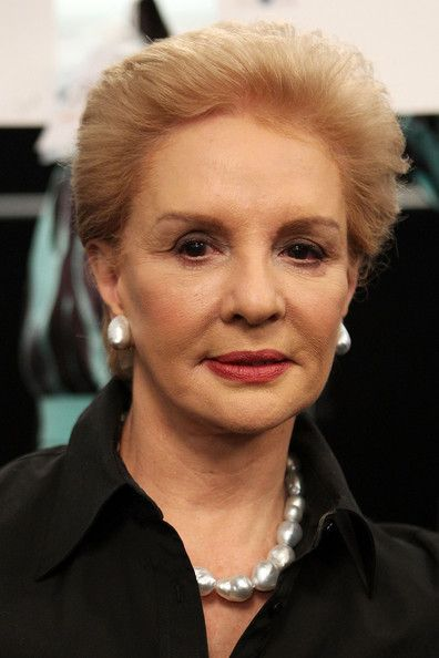 Carolina Herrera wears natural baroque pearl earrings and necklace with the darker version of her classic look.