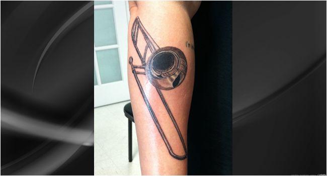 Trombone tattoo by Shawn Pierce at Skin Deep