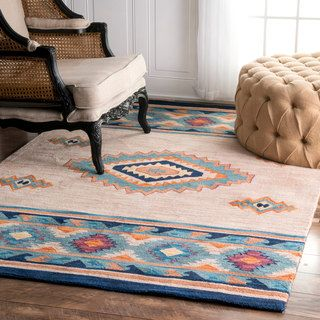 Quality meets value in this beautiful Southwestern modern area rug. Handmade with 100% Polyester to prevent shedding, this area rug will enhance any home decor.