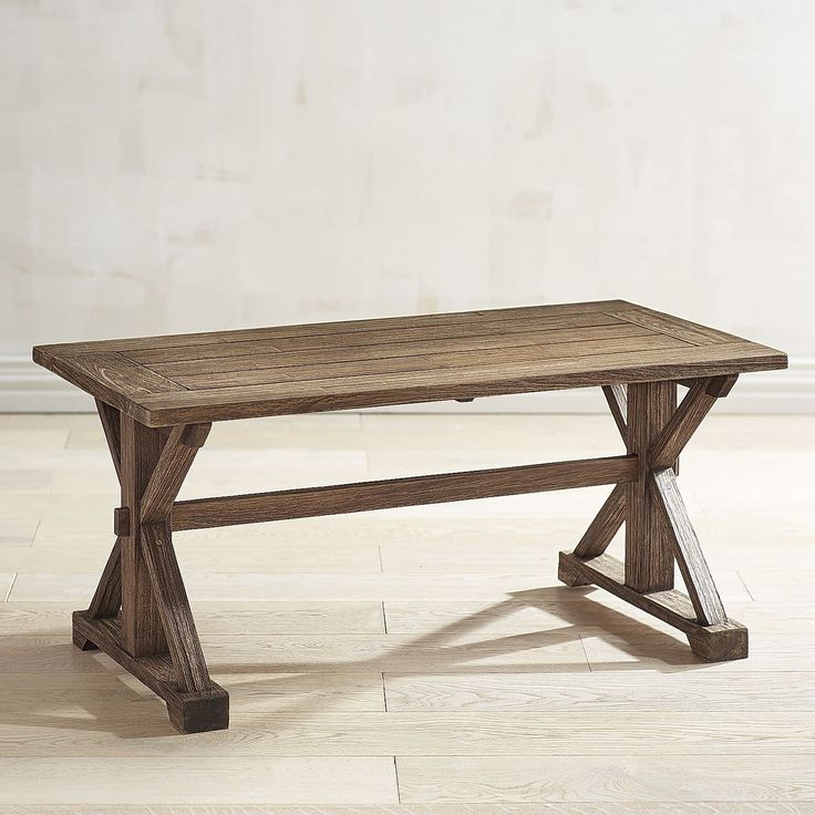 "Remington really puts the ""able"" in table. Farmhouse-inspired with a trestle base, handsome slat top and acacia wood construction, it can go inside or out on your patio. In other words? Versatile and dur(able)!"