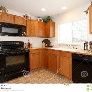 Brown Kitchen Cabinets Black Appliances